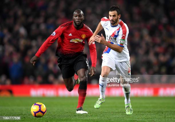 Romelu Lukaku of Manchester United battles for possession with Luka Milivojevic of Crystal Palace during the Premier League match between Manchester...
