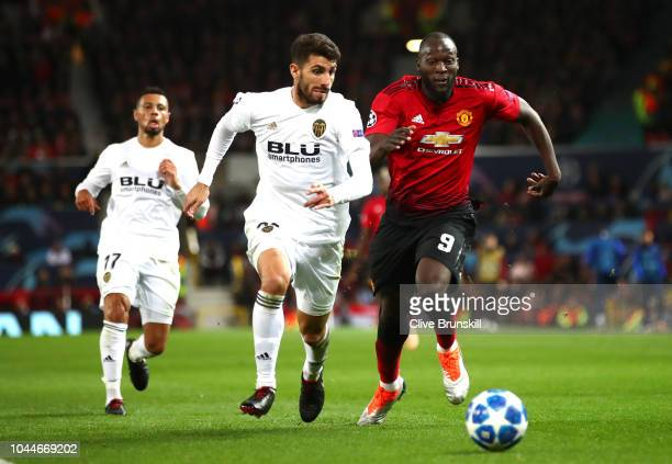 Romelu Lukaku of Manchester United battles for possession with Cristiano Piccini of Valencia during the Group H match of the UEFA Champions League...