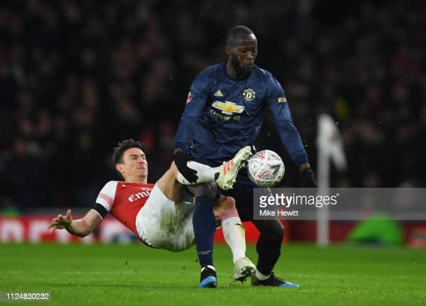 Romelu Lukaku of Manchester United battles with Laurent Koscielny of Arsenal during the FA Cup Fourth Round match between Arsenal and Manchester...