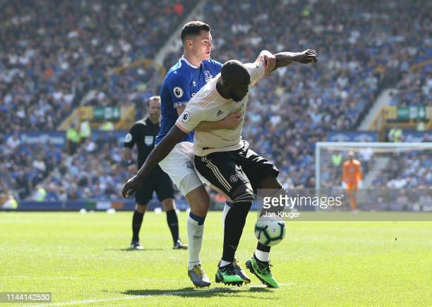 Romelu Lukaku of Manchester United battles with Michael Keane of Everton during the Premier League match between Everton FC and Manchester United at...