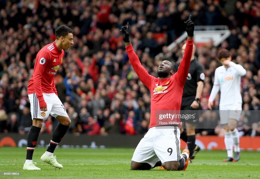 Romelu Lukaku of Manchester United celebrates after he scores the opening goal during the Premier League match between Manchester United and Swansea City at Old Trafford on March 31, 2018 in Manchester, England.