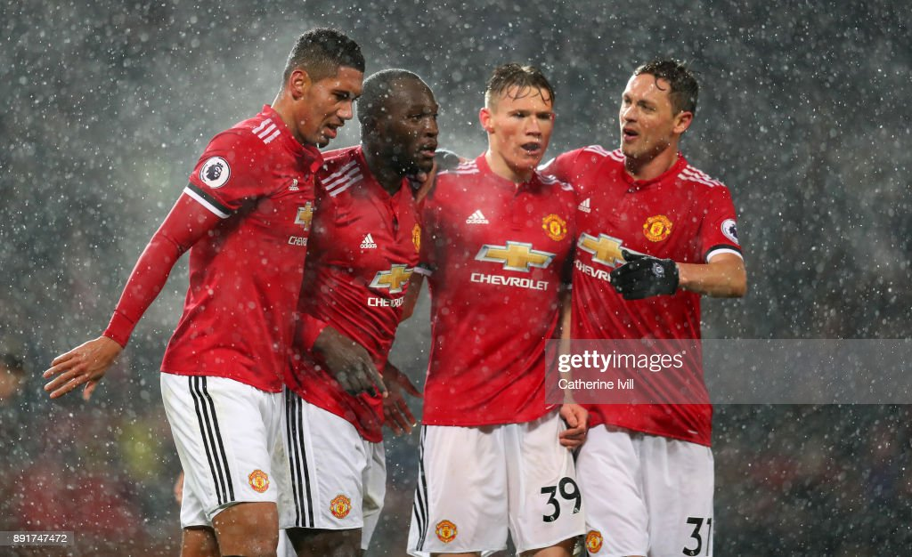 Romelu Lukaku of Manchester United celebrates after scoring his sides first goal with his Manchester United team mates during the Premier League match between Manchester United and AFC Bournemouth at Old Trafford on December 13, 2017 in Manchester, England.