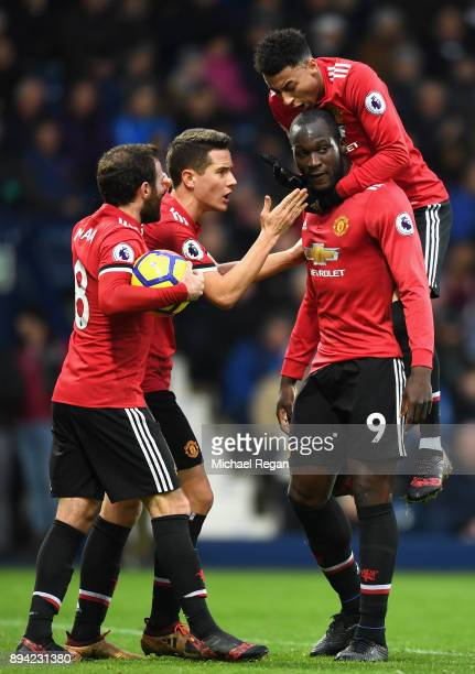 Romelu Lukaku of Manchester United celebrates after scoring his sides first goal with teammates Juan Mata Ander Herrera and Jesse Lingard during the...