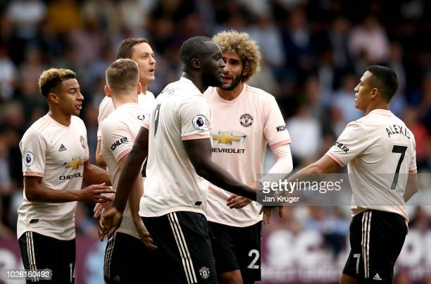 Romelu Lukaku of Manchester United celebrates after scoring his team's first goal with team mates during the Premier League match between Burnley FC...