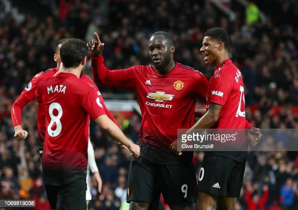 Romelu Lukaku of Manchester United celebrates after scoring his team's third goal with Juan Mata and Marcus Rashford of Manchester United during the...