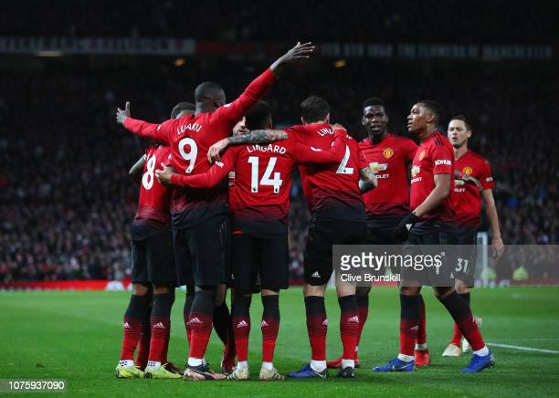 Romelu Lukaku of Manchester United celebrates after scoring his team's fourth goal with team mates during the Premier League match between Manchester...