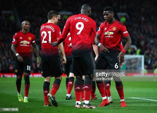 Romelu Lukaku of Manchester United celebrates after scoring his team's fourth goal with Paul Pogba during the Premier League match between Manchester...
