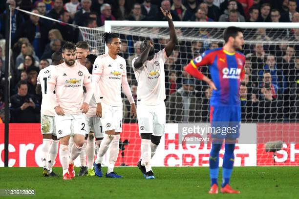 Romelu Lukaku of Manchester United celebrates after scoring his team's first goal during the Premier League match between Crystal Palace and...