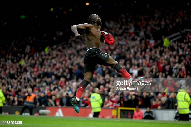 Romelu Lukaku of Manchester United celebrates after scoring his team's third goal during the Premier League match between Manchester United and...