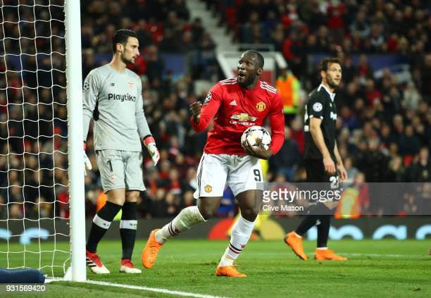 Romelu Lukaku of Manchester United celebrates as he scores their first goal during the UEFA Champions League Round of 16 Second Leg match between...
