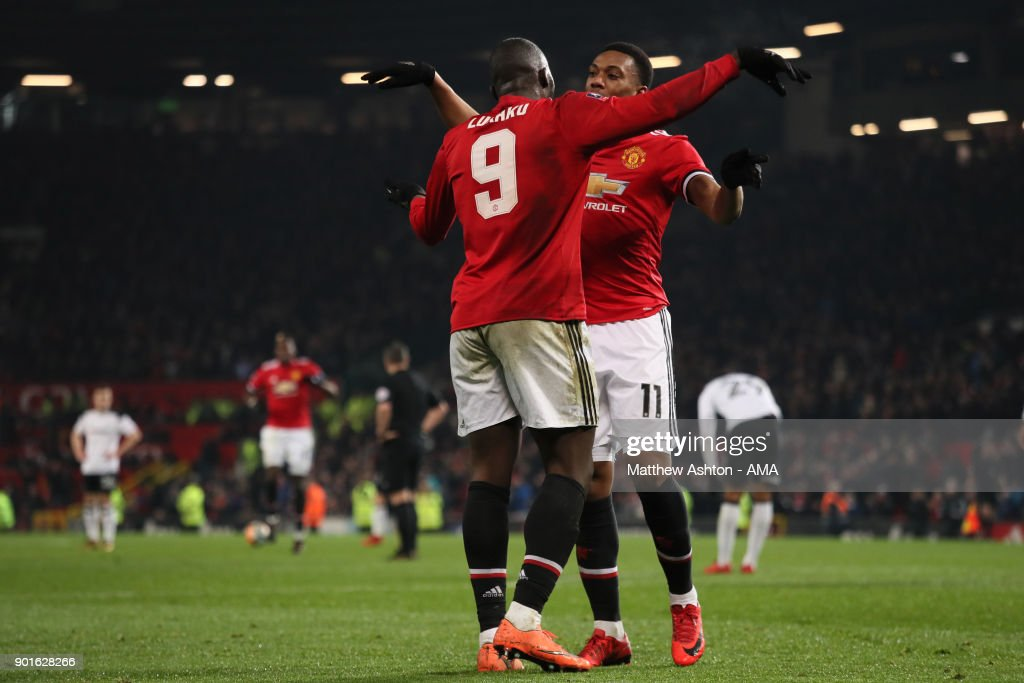 Romelu Lukaku of Manchester United celebrates scoring a goal to make the score 2-0 with Anthony Martial during the Emirates FA Cup Third Round match between Manchester United and Derby County at Old Trafford on January 5, 2018 in Manchester, England.