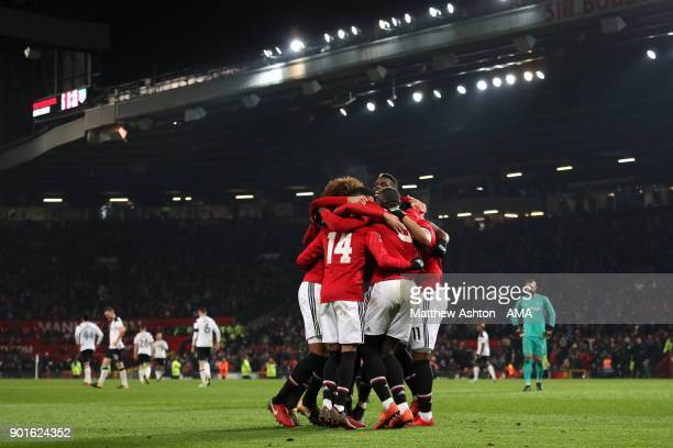Romelu Lukaku of Manchester United celebrates scoring a goal with his teammates to make the score 20 during the Emirates FA Cup Third Round match...
