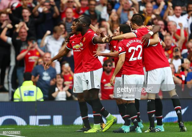 Romelu Lukaku of Manchester United celebrates scoring his sides first goal with his Manchester United team mates during the Premier League match...