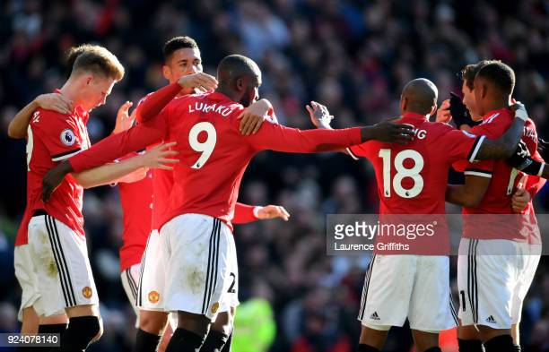 Romelu Lukaku of Manchester United celebrates scoring his sides first goal with team mates during the Premier League match between Manchester United...