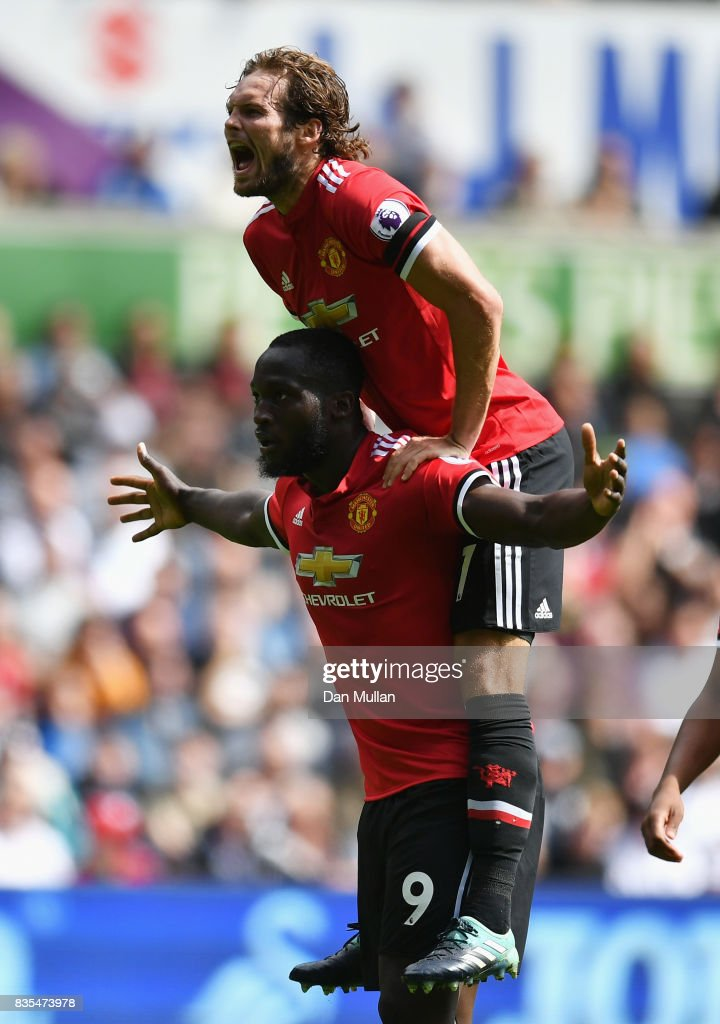 Romelu Lukaku of Manchester United celebrates scoring his sides second goal with Daley Blind of Manchester United during the Premier League match between Swansea City and Manchester United at Liberty Stadium on August 19, 2017 in Swansea, Wales.