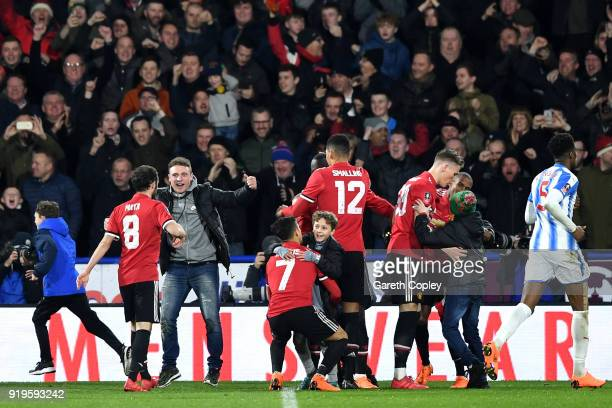 Romelu Lukaku of Manchester United celebrates scoring his side's second goal with fans and team mates during the The Emirates FA Cup Fifth Round...