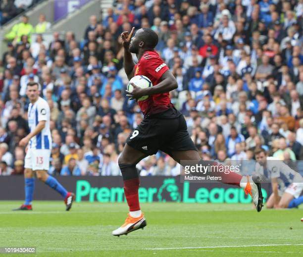 Romelu Lukaku of Manchester United celebrates scoring their first goal during the Premier League match between Brighton Hove Albion and Manchester...