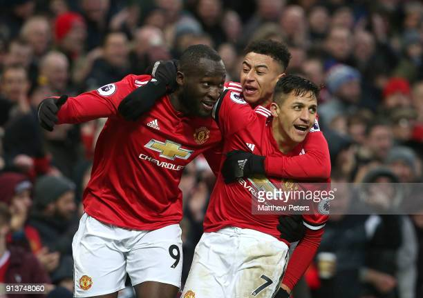 Romelu Lukaku of Manchester United celebrates scoring their first goal during the Premier League match between Manchester United and Huddersfield...