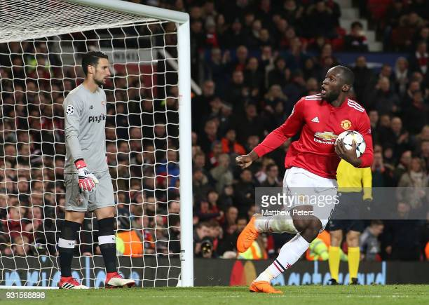 Romelu Lukaku of Manchester United celebrates scoring their first goal during the UEFA Champions League Round of 16 Second Leg match between...