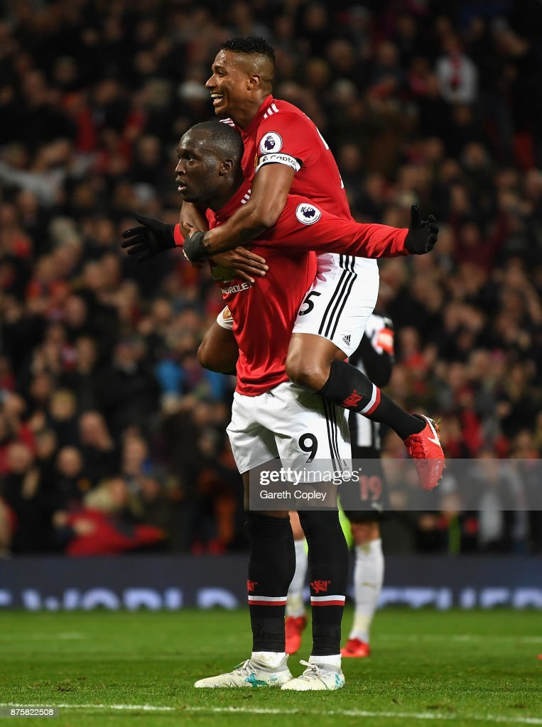 Romelu Lukaku of Manchester United celebrates with Antonio Valencia of Manchester United after scoring his sides fourth goal during the Premier League match between Manchester United and Newcastle United at Old Trafford on November 18, 2017 in Manchester, England.