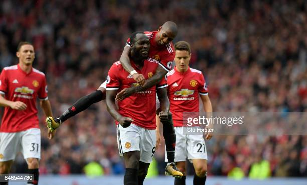 Romelu Lukaku of Manchester United celebrates with Ashley Young scoring his sides third goal during the Premier League match between Manchester...