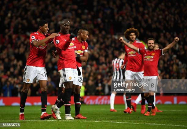 Romelu Lukaku of Manchester United celebrates with team mates after scoring his sides fourth goal during the Premier League match between Manchester...