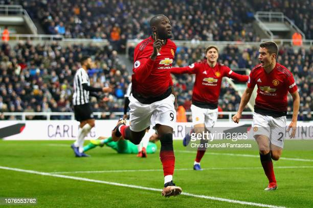 Romelu Lukaku of Manchester United celebrates with teammate Ander Herrera after scoring his sides first goal during the Premier League match between...