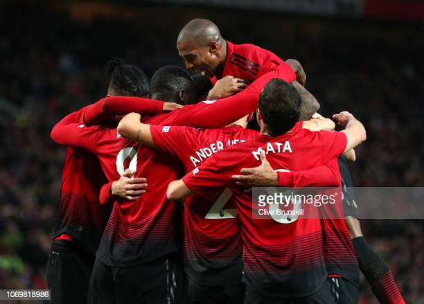 Romelu Lukaku of Manchester United celebrates with teammates after scoring his team's third goal during the Premier League match between Manchester...
