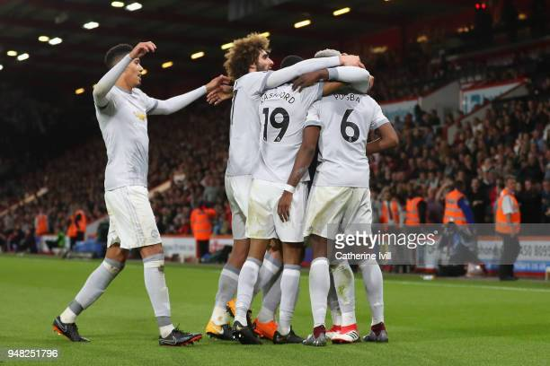Romelu Lukaku of Manchester United celebrates with teammates after scoring his sides second goal during the Premier League match between AFC...