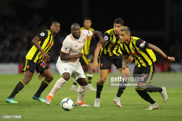 Romelu Lukaku of Manchester United challenges for the ball with Roberto Pereyra of Watford during the Premier League match between Watford FC and...