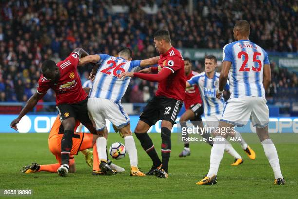 Romelu Lukaku of Manchester United Christopher Schindler of Huddersfield Town and Chris Smalling of Manchester United during the Premier League match...