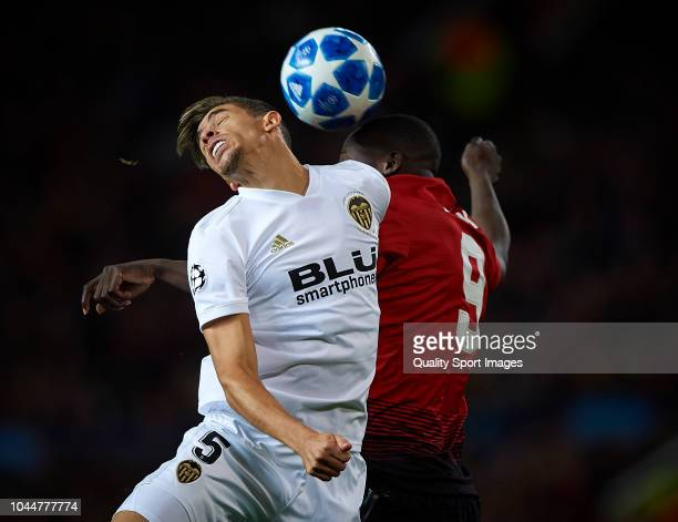 Romelu Lukaku of Manchester United competes for the ball with Gabriel Paulista of Valencia during the Group H match of the UEFA Champions League...