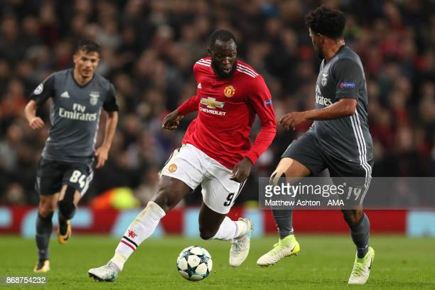 Romelu Lukaku of Manchester United competes with Eliseu of Benfica during the UEFA Champions League group A match between Manchester United and SL...