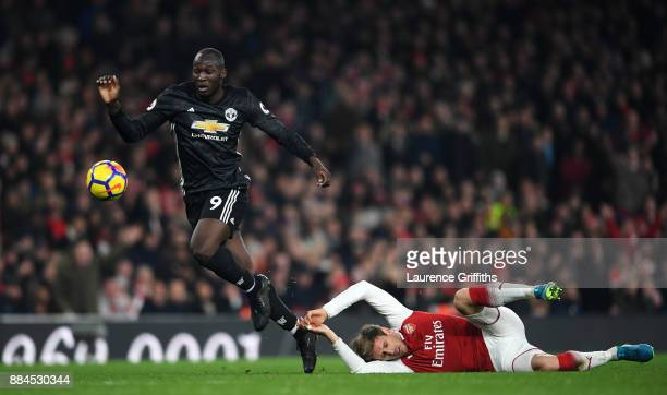 Romelu Lukaku of Manchester United escapes the challenge of Nacho Monreal of Arsenal during the Premier League match between Arsenal and Manchester...