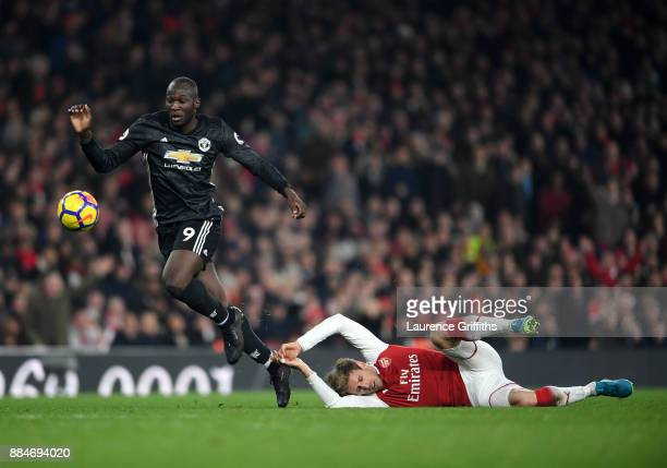 Romelu Lukaku of Manchester United gets tho the ball ahead of Nacho Monreal of Arsenal during the Premier League match between Arsenal and Manchester...