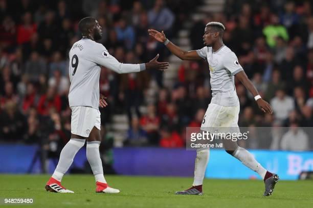 Romelu Lukaku of Manchester United gives Paul Pogba of Manchester United a high five as Paul Pogba of Manchester United is being substituted during...