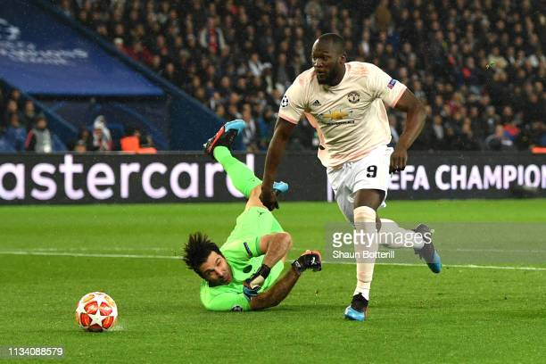 Romelu Lukaku of Manchester United goes past Gianluigi Buffon of PSG to score his sides first goal during the UEFA Champions League Round of 16...