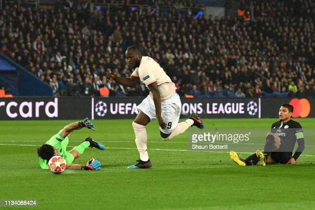 Romelu Lukaku of Manchester United goes past Gianluigi Buffon to score his sides first goal during the UEFA Champions League Round of 16 Second Leg...