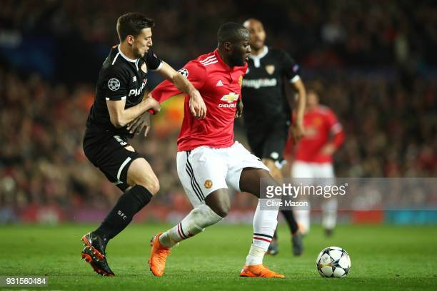 Romelu Lukaku of Manchester United holds off Clement Lenglet of Sevilla during the UEFA Champions League Round of 16 Second Leg match between...