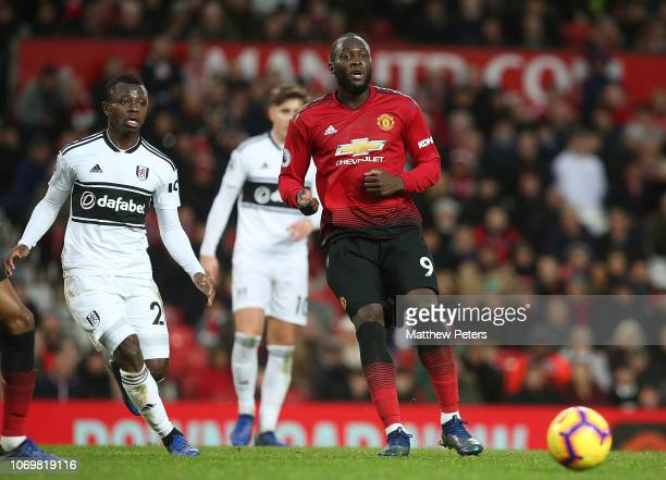 Romelu Lukaku of Manchester United in action with AndreFrank Zambo Anguissa of Fulham FC during the Premier League match between Manchester United...