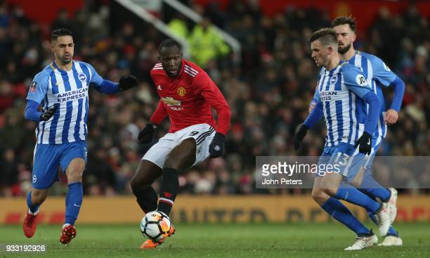 Romelu Lukaku of Manchester United in action with Beram Kayal and Pascal Gross of Brighton Hove Albion during the Emirates FA Cup Quarter Final match...