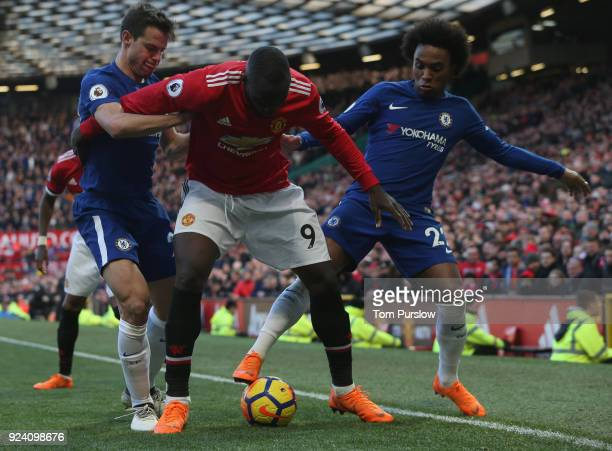 Romelu Lukaku of Manchester United in action with Cesar Azpilicueta and Willian of Chelsea during the Premier League match between Manchester United...