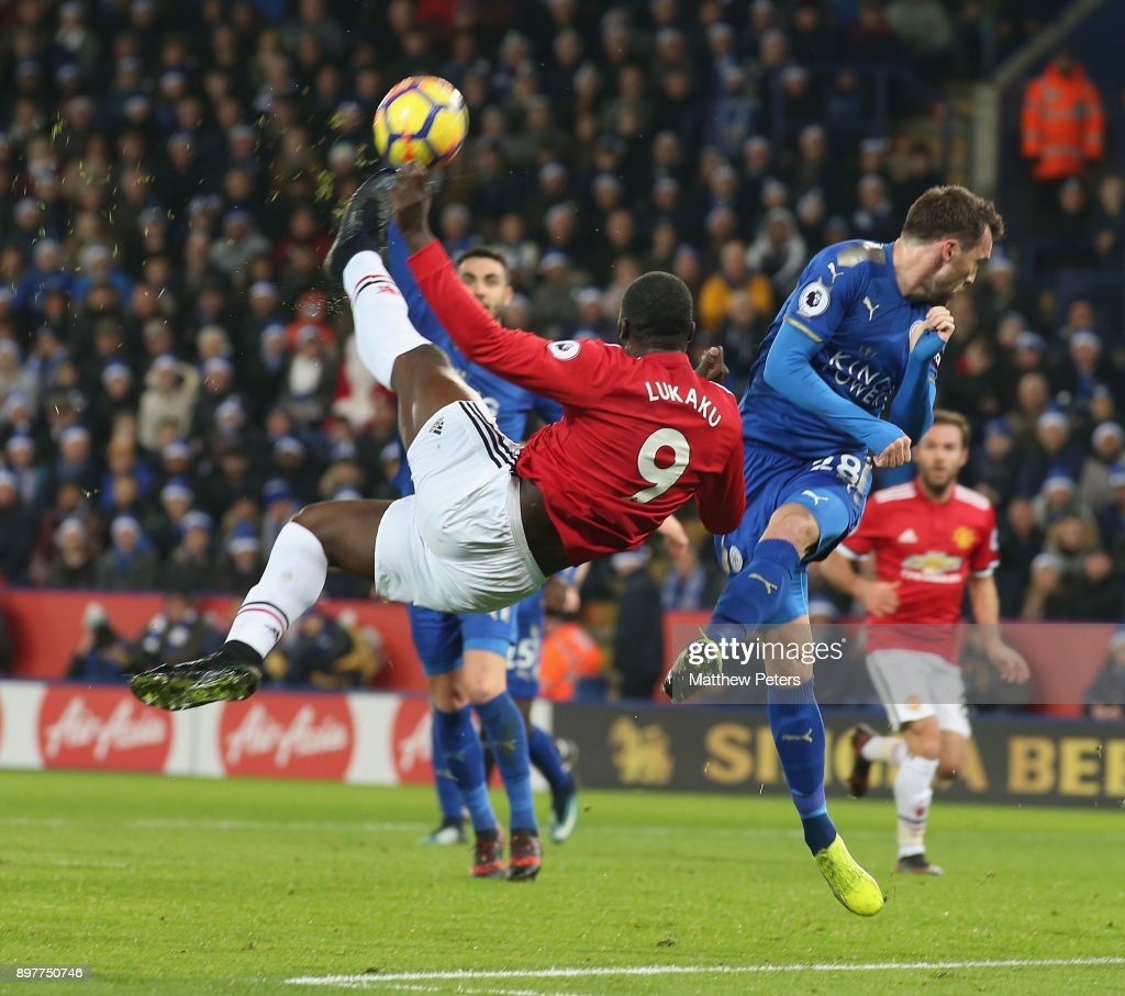 Romelu Lukaku of Manchester United in action with Christian Fuchs of Leicester City during the Premier League match between Leicester City and Manchester United at The King Power Stadium on December 23, 2017 in Leicester, England.