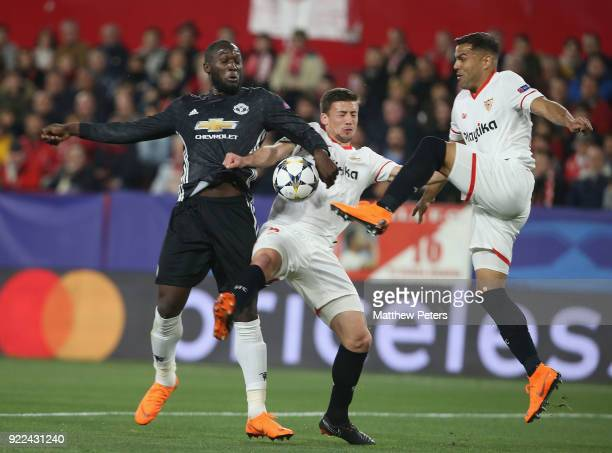 Romelu Lukaku of Manchester United in action with Clement Lenglet and Gabriel Mercado of Sevilla FC during the UEFA Champions League Round of 16...