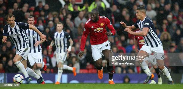 Romelu Lukaku of Manchester United in action with Craig Dawson and Jake Livermore of West Bromwich Albion during the Premier League match between...