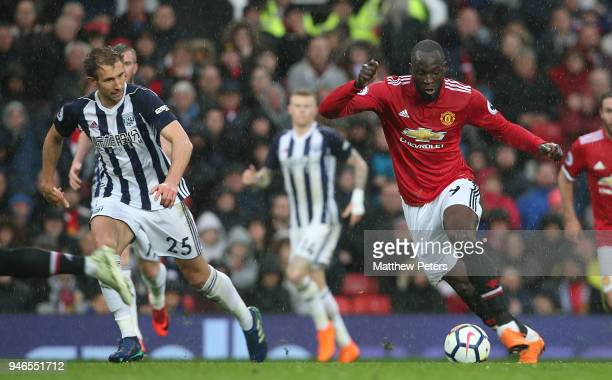 Romelu Lukaku of Manchester United in action with Craig Dawson of West Bromwich Albion during the Premier League match between Manchester United and...