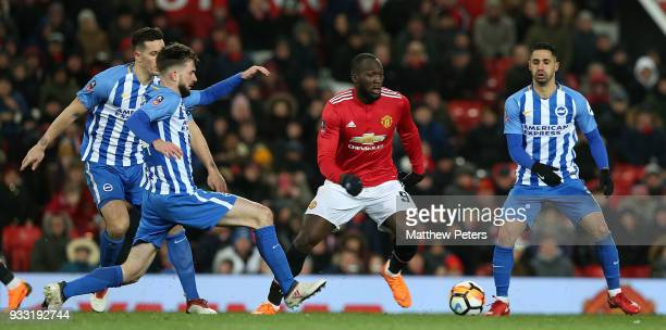 Romelu Lukaku of Manchester United in action with Davy Propper Lewis Dunk and Beram Kayal of Brighton Hove Albion during the Emirates FA Cup Quarter...