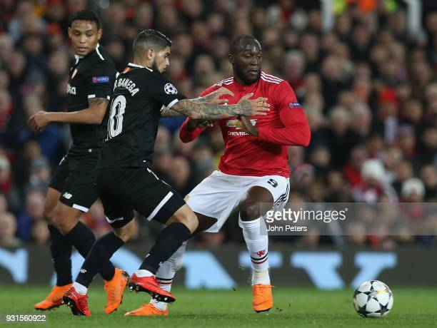 Romelu Lukaku of Manchester United in action with Ever Banega of Sevilla FC during the UEFA Champions League Round of 16 Second Leg match between...