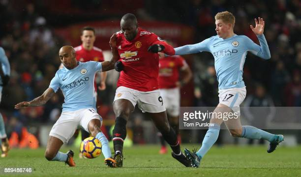 Romelu Lukaku of Manchester United in action with Fabian Delph and Kevin de Bruyne of Manchester City during the Premier League match between...