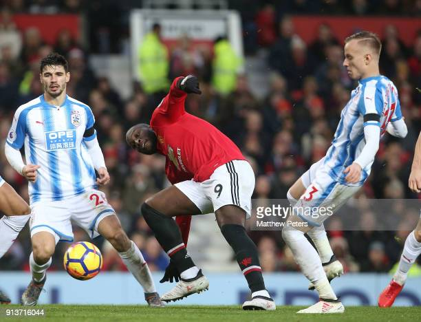 Romelu Lukaku of Manchester United in action with Florent Hadergjonaj of Huddersfield Town during the Premier League match between Manchester United...